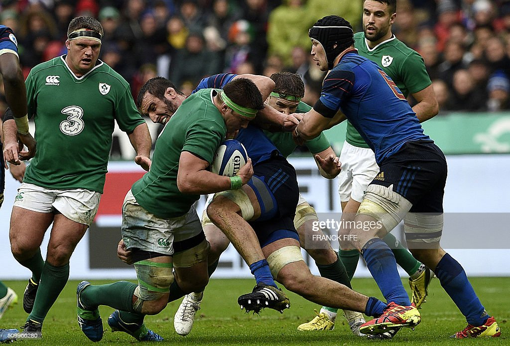 Frances lock Yoann Maestri (Rear C) and France's flanker Wenceslas Lauret (R) vies with Ireland's flanker CJ Stander during the Six Nations international rugby union match between France and Ireland on February 13, 2016 at the Stade de France in Saint-Denis, north of Paris. AFP PHOTO / FRANCK FIFE / AFP / FRANCK FIFE