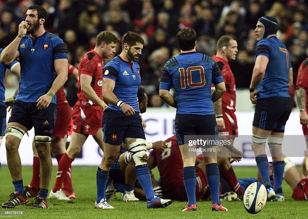 France's lock Yoann Maestri, France's scrum-half Sebastien Tillous-Borde, France's fly-half Camille Lopez and France's flanker Bernard Le Roux react during the Six Nations international rugby union match between France and Wales on February 28, 2015 at the Stade de France in Saint-Denis, north of Paris.
