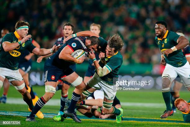 France's lock Yoann Maestri is tackled during the third rugby union Test match between South Africa and France at The Emirates Ellis Park Stadium in...