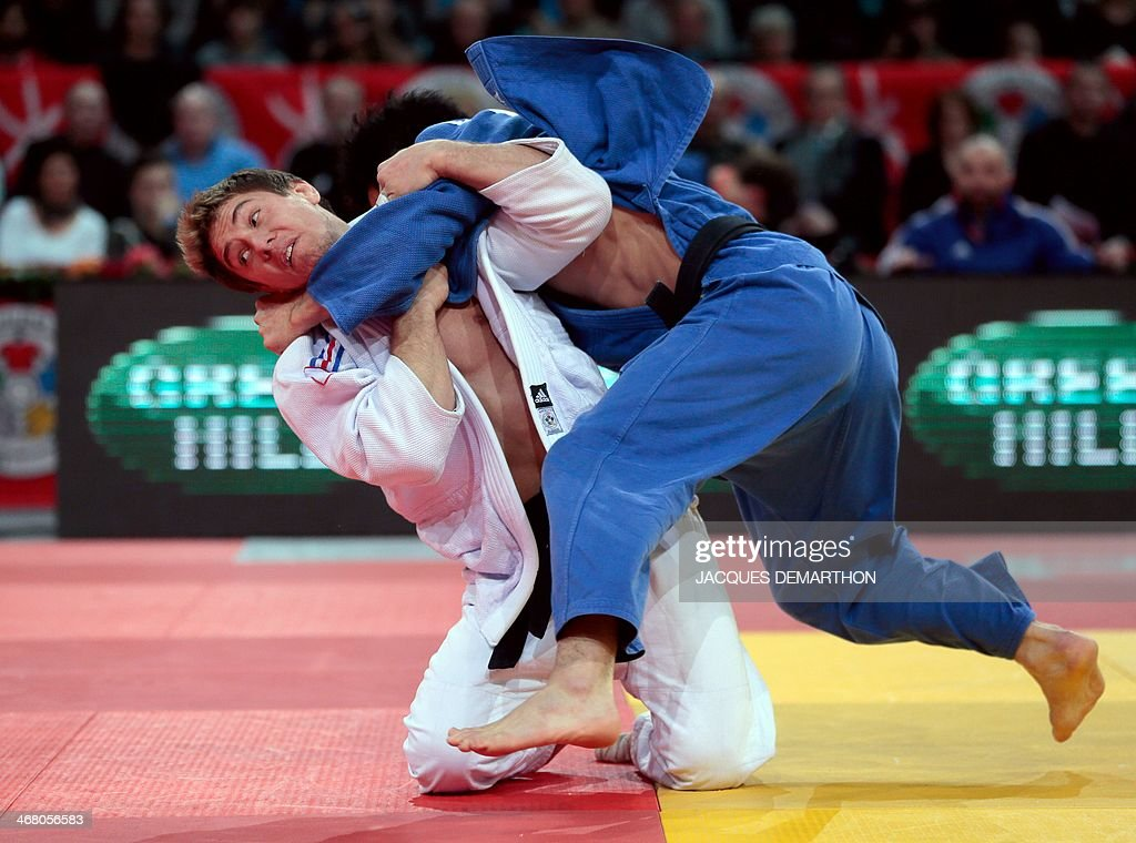 France's Loic Pietri competes with Japan's Nagashima Keita during the men's 81kg quarterfinals at the 2014 Paris Judo Grand Slam tournament on...