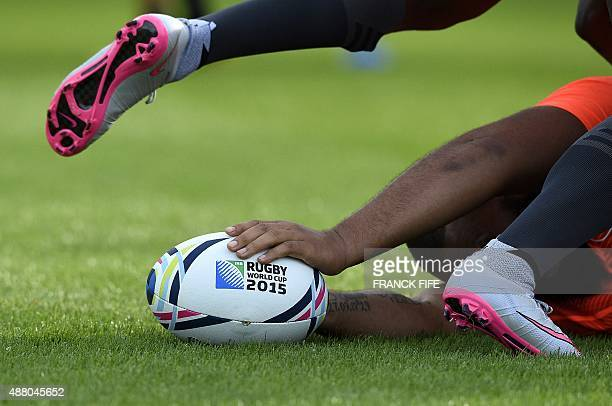 France's loose head prop Uini Atonio reacts during a training session at the Trinity School in Croydon south of London on September 13 2015 where the...