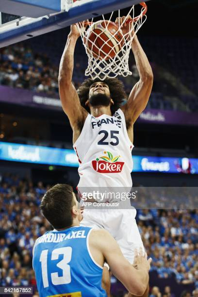 France's Louis Labeyrie scores during the 2017 FIBA Eurobasket mens Group A basketball match between France and Iceland in Helsinki Finland on...