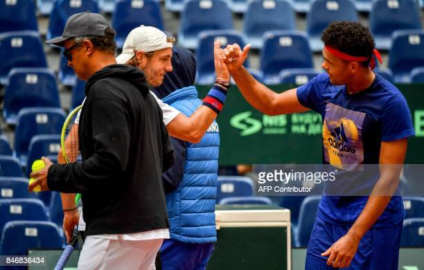 France's Lucas Pouille and France's JoWilfried Tsonga take part in a training session ahead of the Davis Cup World Group semifinal between France and...