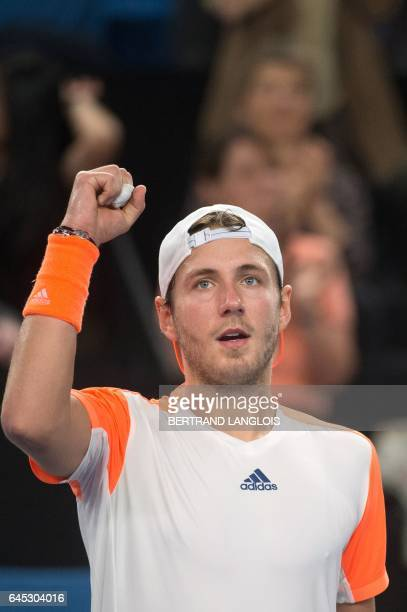 France's Lucas Pouille celebrates after defeating France's Richard Gasquet during the ATP Marseille Open 13 tennis semifinal match in Marseille...