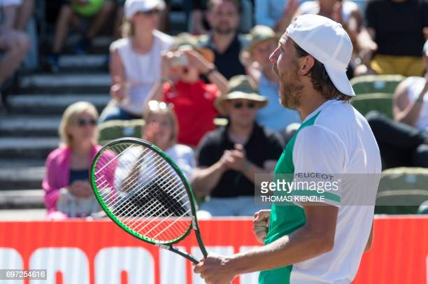 France's Lucas Pouille celebrates after defeating Spain's Feliciano Lopez in the final match at the ATP Mercedes Cup tennis tournament in Stuttgart...