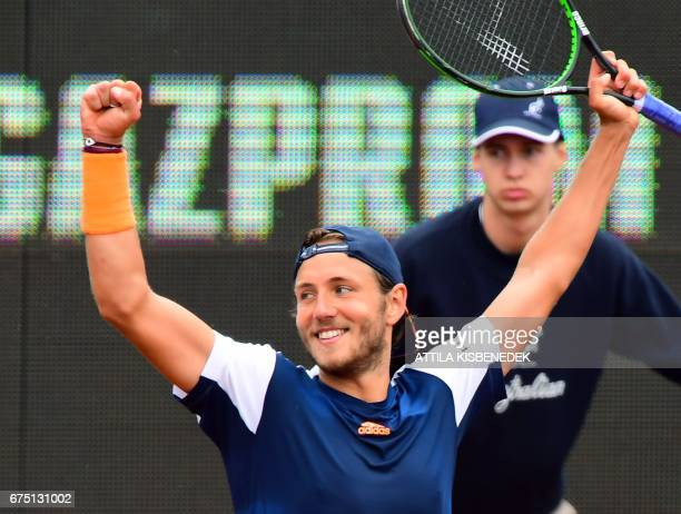 France's Lucas Pouille celebrates his victory over Britain's Aljaz Bedene after their final tennis match at the Hungarian Open in Budapest on April...