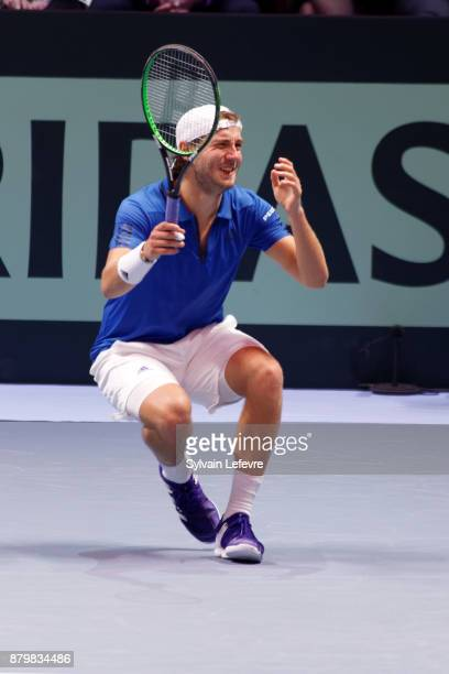 France's Lucas Pouille celebrates winning the Davis Cup after winning his match against Belgium's Steve Darcis during day 3 of the Davis Cup World...