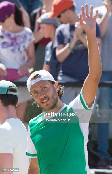 France's Lucas Pouille reacts after defeating Spain's Feliciano Lopez in the final match at the ATP Mercedes Cup tennis tournament in Stuttgart...