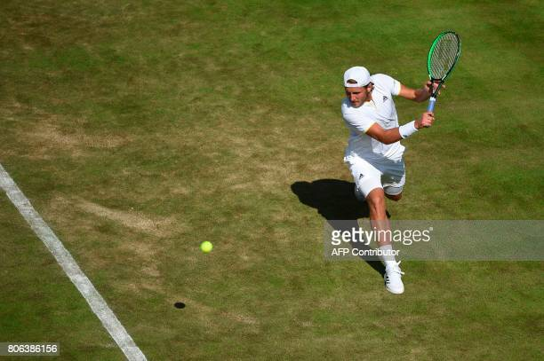 France's Lucas Pouille returns against Tunisia's Malek Jaziri during their men's singles first round match on the first day of the 2017 Wimbledon...