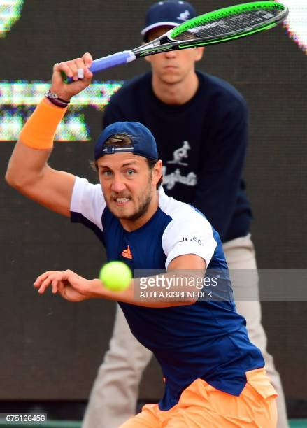 France's Lucas Pouille returns the ball to Britain's Aljaz Bedene during their final tennis match at the Hungarian Open in Budapest on April 30 2017...
