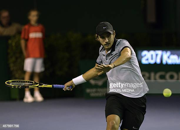 France's Lucas Pouille returns the ball to Croatia's Ivo Karlovic during the second round match at the ATP World Tour Masters 1000 indoor tennis...