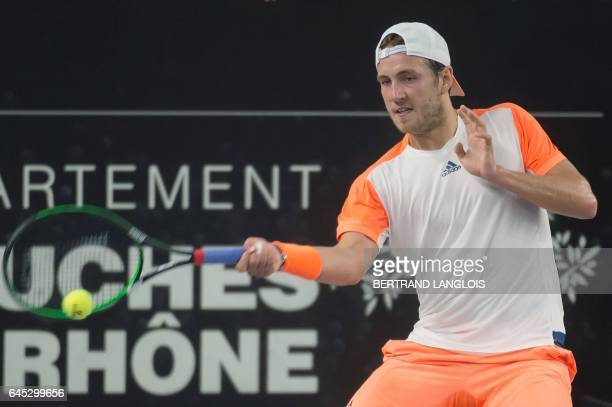 France's Lucas Pouille returns the ball to France's Richard Gasquet during the ATP Marseille Open 13 tennis semi final match in Marseille southern...