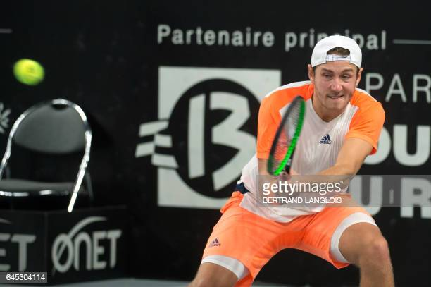 France's Lucas Pouille returns the ball to France's Richard Gasquet during the ATP Marseille Open 13 tennis semifinal match in Marseille southern...