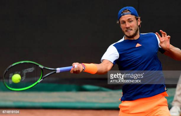 France's Lucas Pouille returns the ball to Italy's Paolo Lorenzi during their semifinal tennis match at the Hungarian Open in Budapest on April 29...