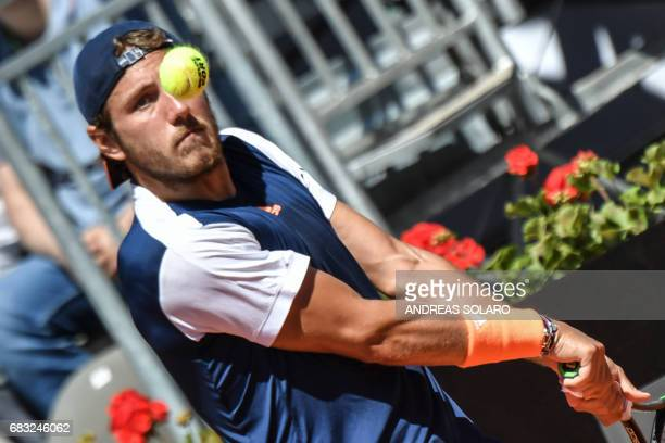 France's Lucas Pouille returns the ball to US Sam Querrey during their ATP Tennis Open tournament match on May 15 2017 at the Foro Italico in Rome /...