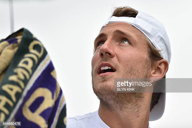 France's Lucas Pouille sits in the break between games against Australia's Bernard Tomic during their men's singles fourth round match on the eighth...