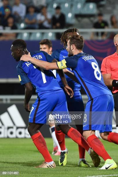 France's Lucas Tousart congratulates teammate JeanKevin Augustin after he scored during their U20 World Cup round of 16 football match between France...