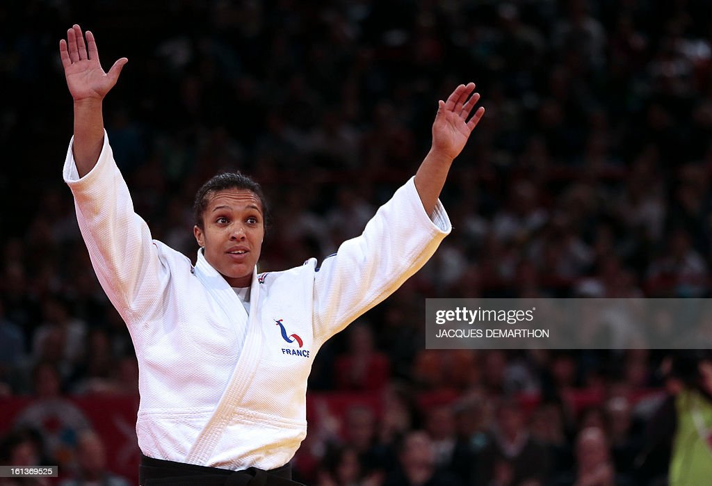 France's Lucie Decosse celebrates after winning the Bronze medal of the Women -70kg contest at the Paris' Judo Grand Slam tournament on february 10, 2013 in Paris. AFP PHOTO / JACQUES DEMARTHON