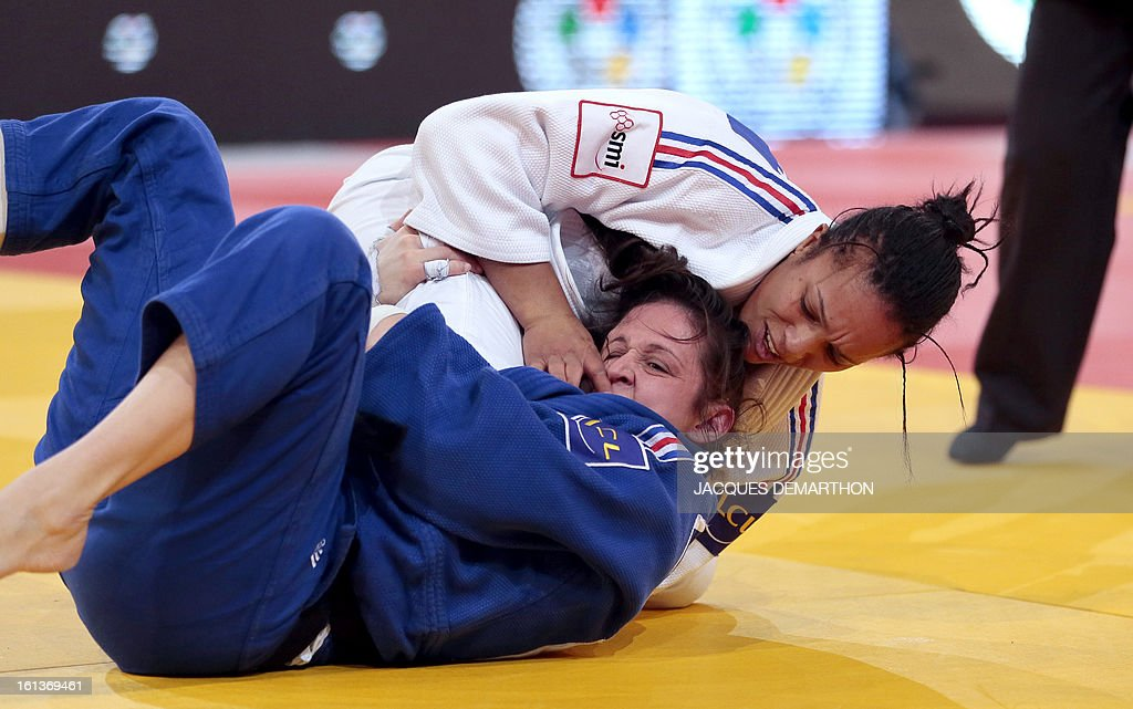 France's Lucie Decosse (R) competes against France's Marie Pasquet on February 10, 2013 for the bronze medal of the Women -70kg category during the Paris International Judo tournament, part of the Grand Slam, at the Palais Omnisports de Paris-Bercy (POPB) in Paris.