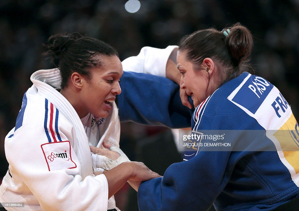 France's Lucie Decosse (L) competes against France's Marie Pasquet on February 10, 2013 for the bronze medal of the Women -70kg category during the Paris International Judo tournament, part of the Grand Slam, at the Palais Omnisports de Paris-Bercy (POPB) in Paris.