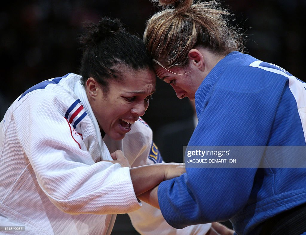 France's Lucie Decosse (white) fights against Tunisia's Houda Miled (blue) on February 10, 2013 in Paris, during the eliminatories of the Women -70kg of the Paris Judo Grand Slam tournament.