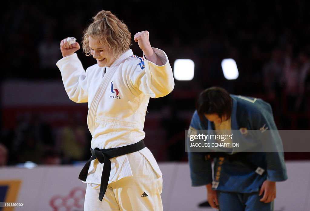 France's Lucie Louette (L) celebrates after defeating Japan's Ogata Akari (R) on February 10, 2013 during their Women -78Kg final of the Paris International Judo tournament, part of the Grand Slam, at the Palais Omnisports de Paris-Bercy (POPB) in Paris.
