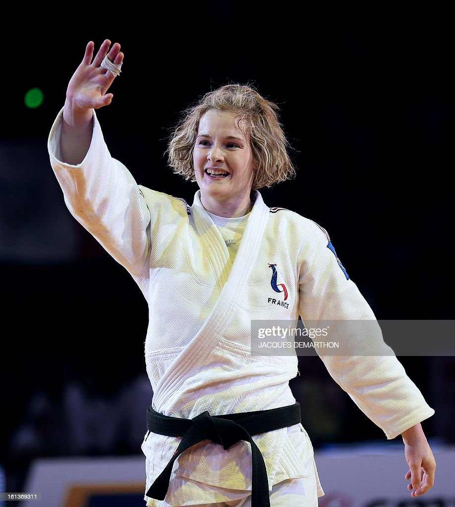 France's Lucie Louette (L) celebrates after defeating Japan's Ogata Akari (not pictured) on February 10, 2013 during their Women -78Kg final of the Paris International Judo tournament, part of the Grand Slam, at the Palais Omnisports de Paris-Bercy (POPB) in Paris.