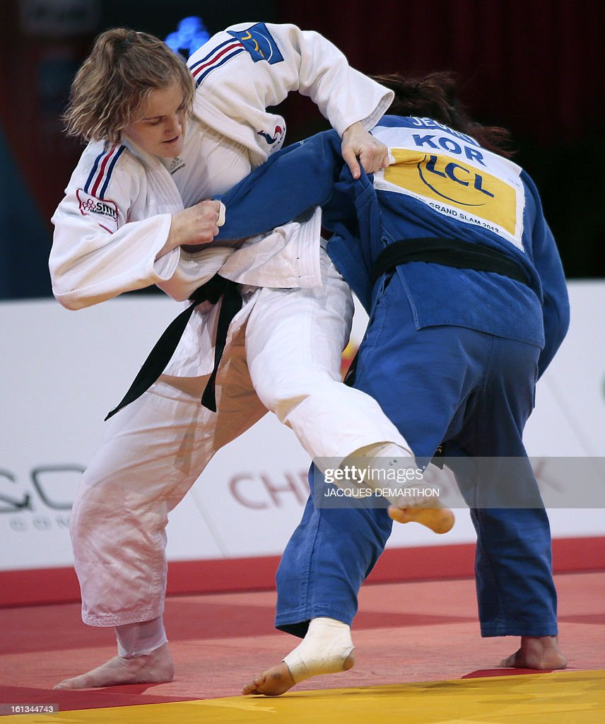 France's Lucie Louette (white) fights against South Korea's Jeong Gyeong-Mi on February 10, 2013, during the Women -78kg semi-finals of the Paris International Judo tournament, part of the Grand Slam, at the Palais Omnisports de Paris-Bercy (POPB) in Paris.