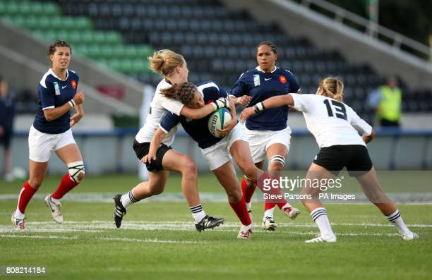 France's Lucille Godiveau is tackled by New Zealand's Kelly Brazier and Huriana Manuel during the Women's Rugby World Cup Semi Finals at Twickenham...