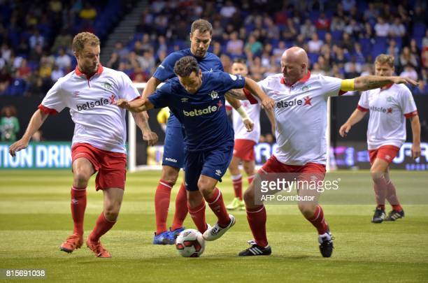 France's Ludovic Giuly vies with Denmark's Hjalte Norregaard and Denmark's Stig Tofting during the Star Sixes final football match between France and...
