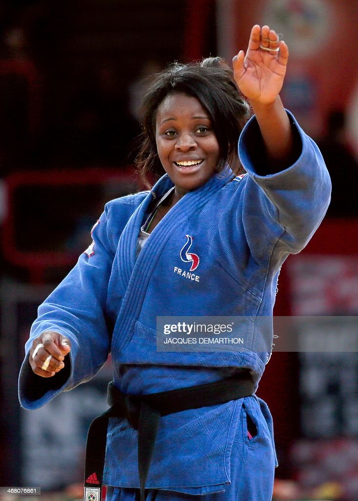 France's Madeleine Malonga celebrates her victory over China's Xin Li in the women's 78kg semifinals at the 2014 Paris Judo Grand Slam tournament on...