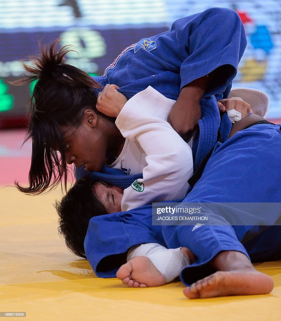 France's Madeleine Malonga pins down China's Xin Li for ippon during the women's 78kg semifinals at the 2014 Paris Judo Grand Slam tournament on...