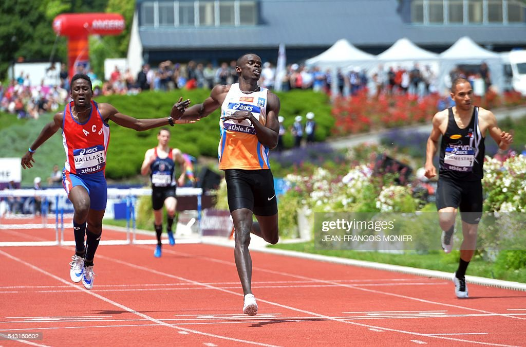 France's Mamadou Kasse Hann (C) crosses the finish line and wins 400m hurdles final of the French Athletics Elite championships on June 26, 2016 at the Lac de Maine stadium in Angers, western France. / AFP / JEAN