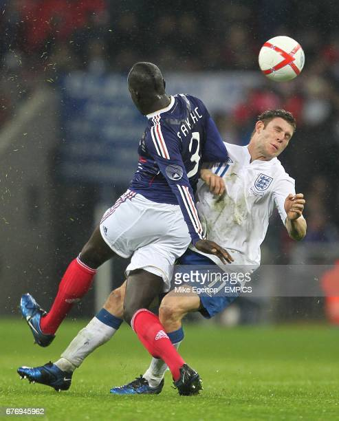 France's Mamadou Sakho and England's James Milner battle for the ball