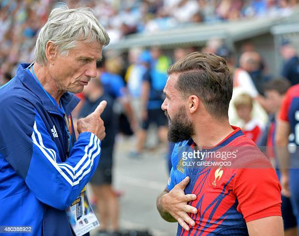 France's manager Jeanclaude Skrela talks to Terry Bouhraoua after their game against Germany during the European Rugby Sevens Grand Prix Series rugby...