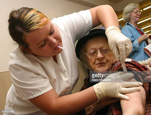 Frances Mandina gets her flu shot from nurse Kin Robbins at the Albertson Super Market October 12 2004 in Bossier City Louisiana About 100 elderly...