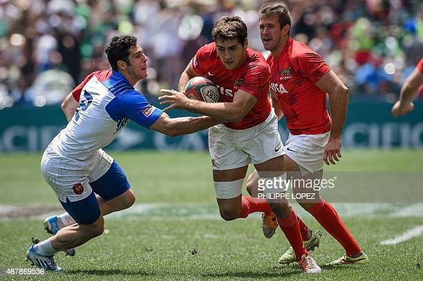 France's Manoel Dall Igna tries to tackle Argentina's Santiago Alvarez during a match between France and Argentina on the second day of the rugby...