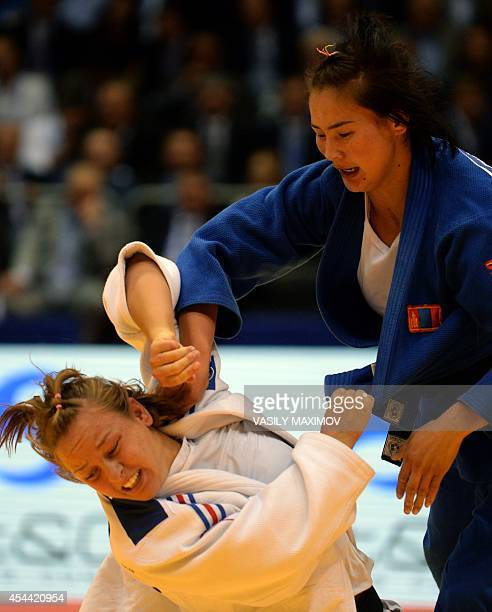 France's Margaux Pinot competes for the first place with Mongolia's Naranjargal Tsend Ayush during the team final competition at the World Judo...