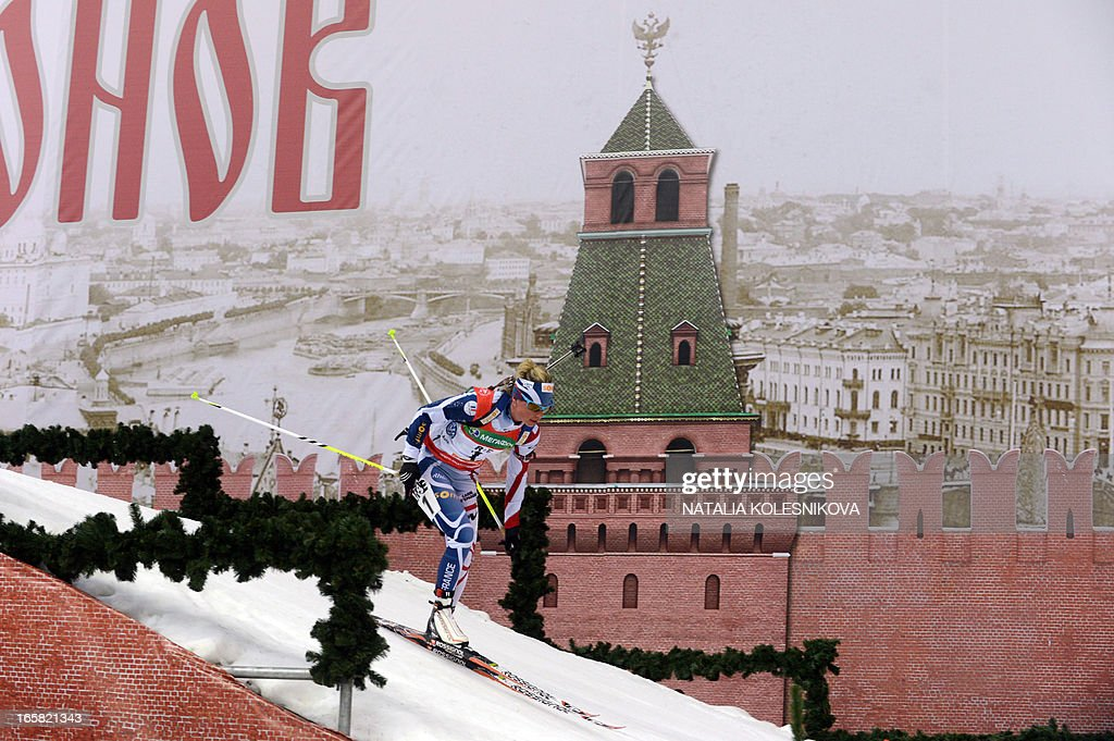 France's Marie Dorin competes on April 6, 2013 in the women's biathlon mass start during the Champion's Race in Moscow .