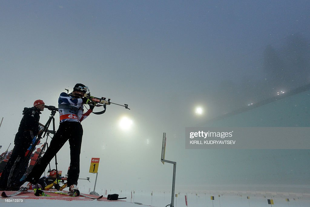 France's Marie Dorin Habert (in front) prepares to shoot in fog during a training session before the Women 7.5 km Sprint during IBU World Cup Biathlon at Laura Cross Country and Biathlon Centre in Sochi on March 9, 2013.