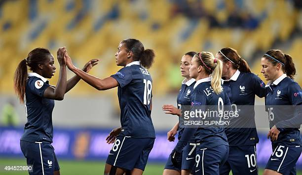 France's MarieLaure Delie celebrates with her teammates during the Women's EURO 2017 Group 3 qualifying football match Ukraine vs France at Arena...