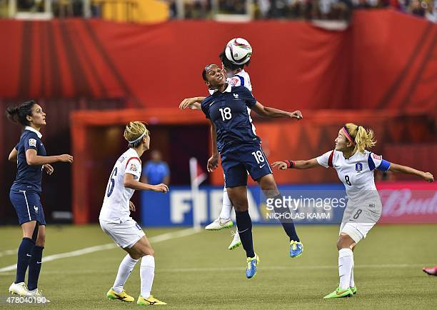 France's MarieLaure Delie fights for the ball with South Korea's Kim Sooyun as France's Louisa Necib and South Koreans Cho Sohyun and Kang Yumi look...