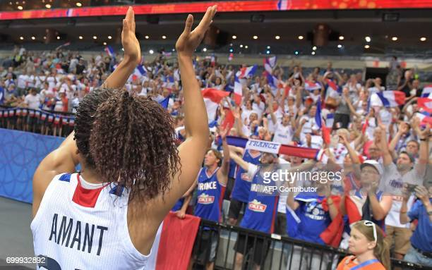 France's Marielle Amant celebrates victory with the fans after the FIBA EuroBasket 2017 women's quarterfinal match between France and Slovakia on...