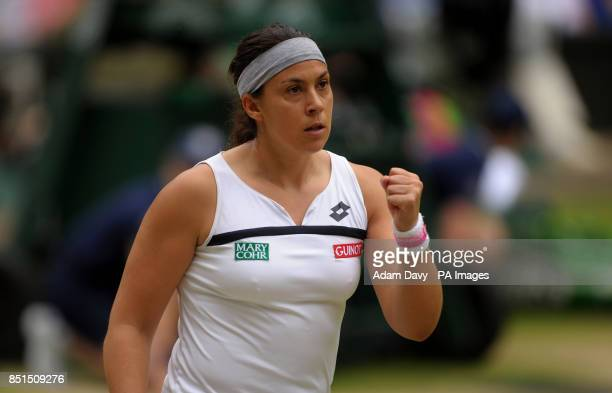 France's Marion Bartoli celebrates a point against Belgium's Kirsten Flipkens during day ten of the Wimbledon Championships at The All England Lawn...