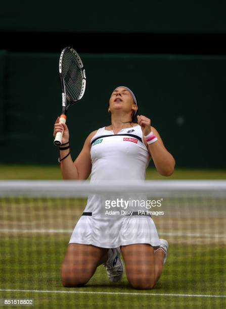 France's Marion Bartoli celebrates beating Belgium's Kirsten Flipkens during day ten of the Wimbledon Championships at The All England Lawn Tennis...