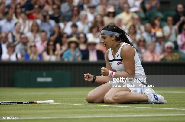 France's Marion Bartoli celebrates defeating Belgium's Kirsten Flipkens during day ten of the Wimbledon Championships at The All England Lawn Tennis...