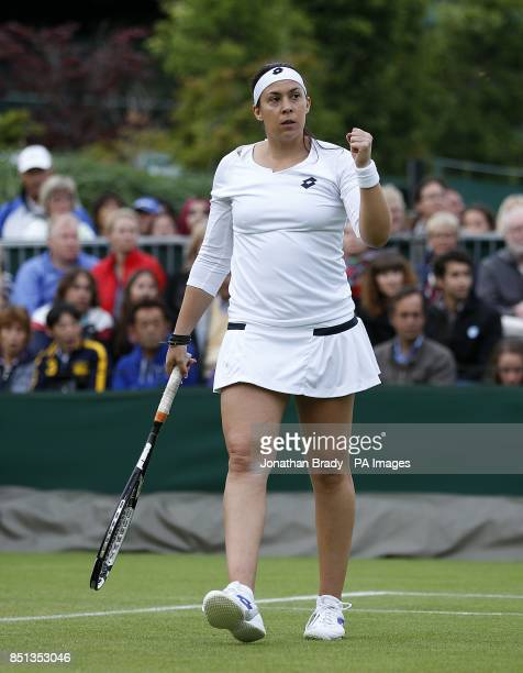 France's Marion Bartoli celebrates during her match against Ukraine's Elina Svitolina during day one of the Wimbledon Championships at The All...