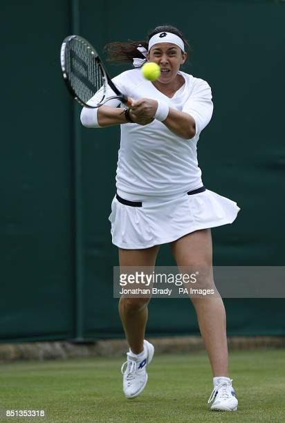 France's Marion Bartoli in action against Ukraine's Elina Svitolina during day one of the Wimbledon Championships at The All England Lawn Tennis and...