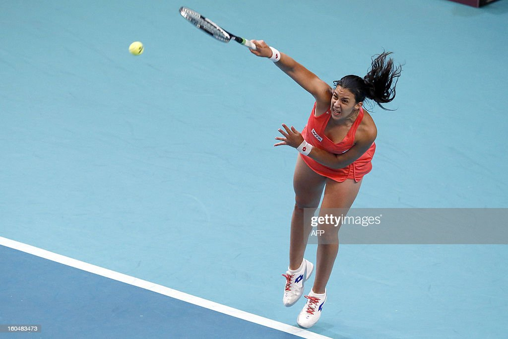 France's Marion Bartoli serves to Germany's Mona Barthel at the 21st edition of the Paris WTA Open on February 1, 2013. AFP PHOTO KENZO TRIBOUILLARD