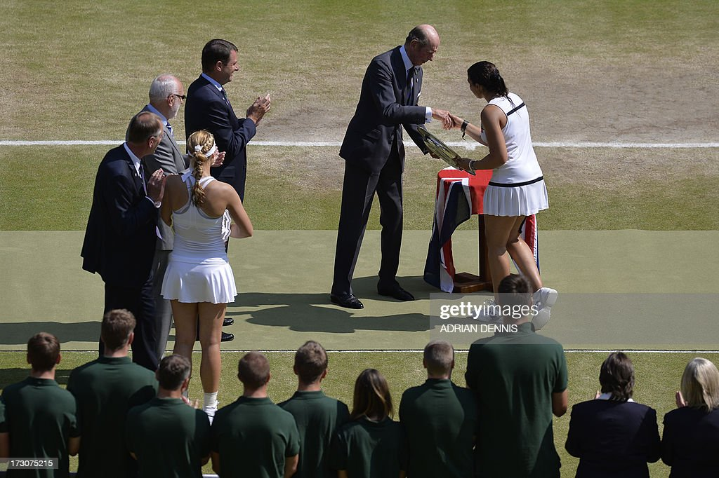 France's Marion Bartoli (R) shakes hands with Prince Edward, Duke of Kent, during the presentation after winning the women's singles final match against Germany's Sabine Lisicki (L) on day twelve of the 2013 Wimbledon Championships tennis tournament at the All England Club in Wimbledon, southwest London, on July 6, 2013. Bartoli won 6-1, 6-4. AFP PHOTO / POOL / ADRIAN DENNIS - RESTRICTED TO EDITORIAL USE